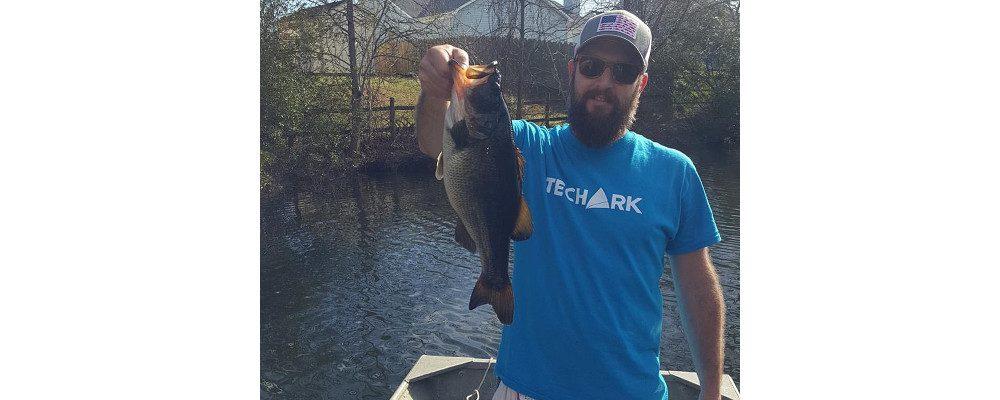 TechArk design lead catching a fish
